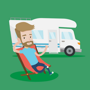 Hipster man with the beard sitting in a folding chair and giving thumb up on the background of camper van. Young man enjoying vacation in camper van. Vector flat design illustration. Square layout