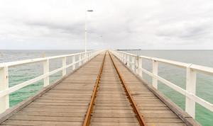 Historic Busselton Jetty in Western Australia, longest timber pier in the Southern Hemisphere, with railway line.