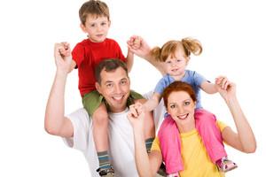 Horizontal image of family having fun in studio