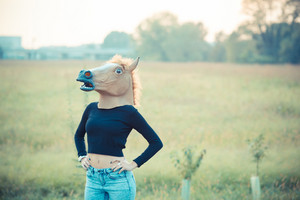 horse mask young beautiful brunette straight hair woman outdoor