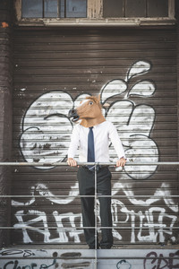 horse mask young handsome elegant blonde model man in the city