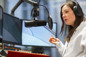 Host Talking On Microphone In Radio Studio