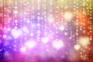 illuminated hearts on colorful grunge background