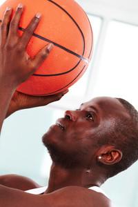 Image of a basketball player throwing ball into basket
