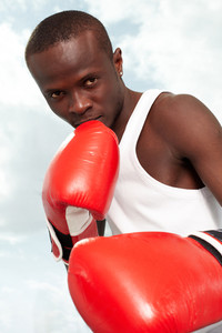 Image of a boxer in red gloves ready to attack his rival