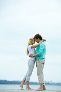 Image of affectionate man and woman embracing each other during vacation