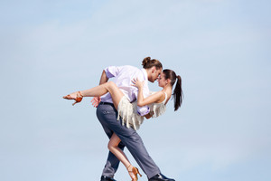 Image of beautiful couple dancing outside