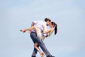 Image of beautiful couple dancing outside