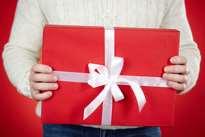 Image of giftbox held by male