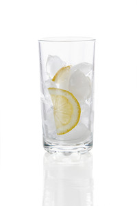 Image of glass with slices of lemon and ice