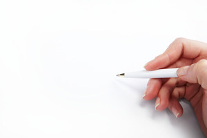 Image of hand with pen over blank paper