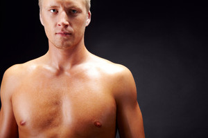 Image of handsome man with bare torso looking at camera