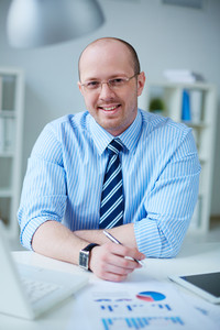 Image of happy businessman in formalwear working in office