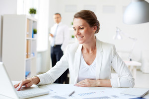 Image of happy businesswoman networking at workplace