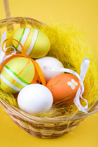 Image of several colored Easter eggs in basket
