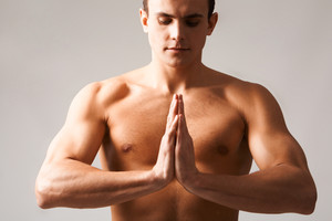 Image of shirtless man keeping his hands put together by chest