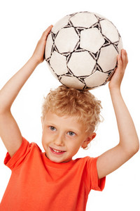 Image of sport boy holding ball over head