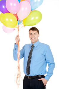 Image of successful businessman holding colorful balloons and looking at camera