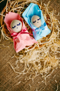 Image of two baby Easter eggs wrapped into pink and blue paper