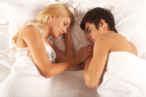 Image of young couple sleeping