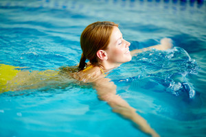 Image of young female swimming in pool