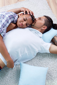 Image of young guy and his girlfriend relaxing at home
