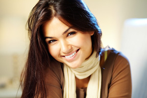 Image of young woman with dark hair smiling at camera