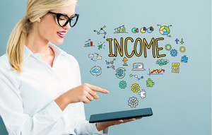 Income text with business woman using a tablet