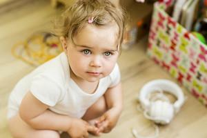 Indoor portrait of cute little girl smiling