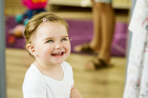 Indoor portrait of cute little girl smiling