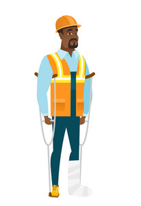 Injured african-american builder with broken leg on crutches. Builder with broken leg in bandages. Full length of builder with broken leg. Vector flat design illustration isolated on white background.