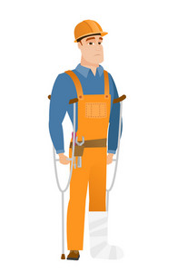 Injured caucasian builder with broken leg on crutches. Young builder with broken leg in bandages. Full length of builder with broken leg. Vector flat design illustration isolated on white background.