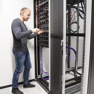 IT consultant building network rack in datacenter