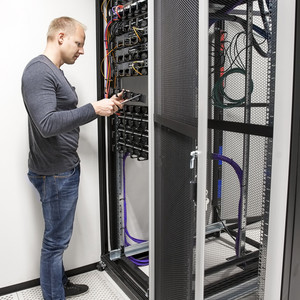 IT consultant install data racks in datacenter