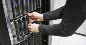 IT consultant working with blade server in datacenter