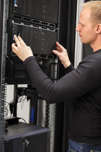 It consultant working with installation of a server in datacenter