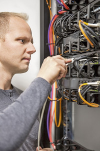 IT consultant working with network switches
