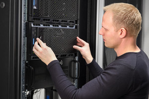 It consultant working with rack server in datacenter