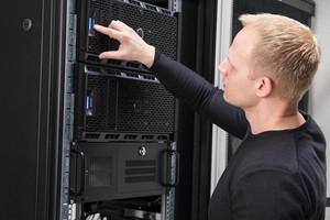 It consultant working with servers in datacenter