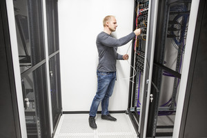 IT consultant works with network in datacenter