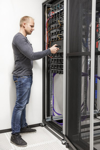 IT engineer building network rack in datacenter
