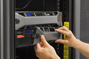 It engineer / consultant working in a data center. Rack server.