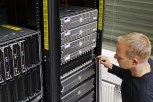 It engineer / consultant working in a data center. This enclosures is a SAN (storage area network) and servers at the top.