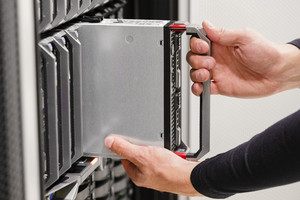 IT professional installs server cluster in large datacenter