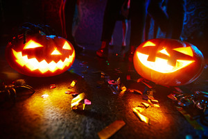 Jack-o-lanterns shining on dance floor
