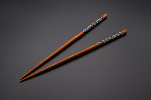Japanese chopsticks for asian food on black background.