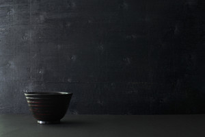 Japanese wooden bowl on the table and black color wooden background