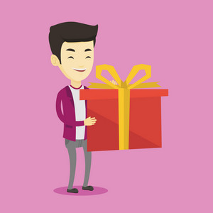 Joyful asian man holding a box with gift in hands. Happy man holding gift box. Young man standing with gift box. Guy buying a present. Vector flat design illustration. Square layout.