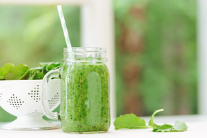Kale and greens smoothie beverage in a bright room
