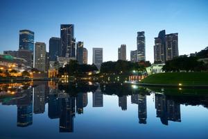 Kuala Lumpur city downtown at before sunrise with reflection of skyline, Kuala Lumpur, Malaysia